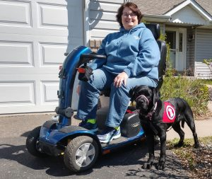 woman using wheelchair and service dog