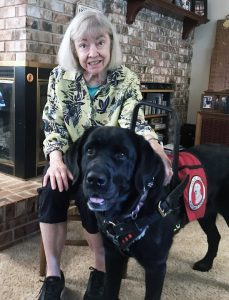 woman with black service dog