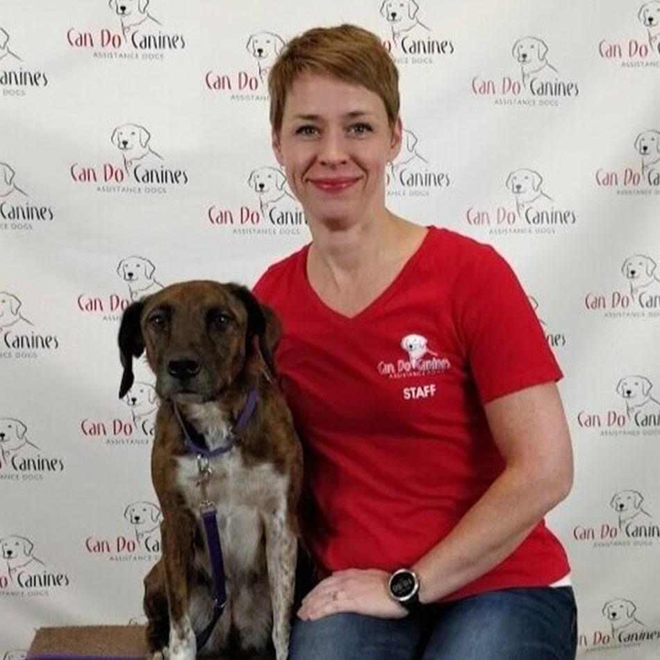 Cari Bishop sitting with a dog