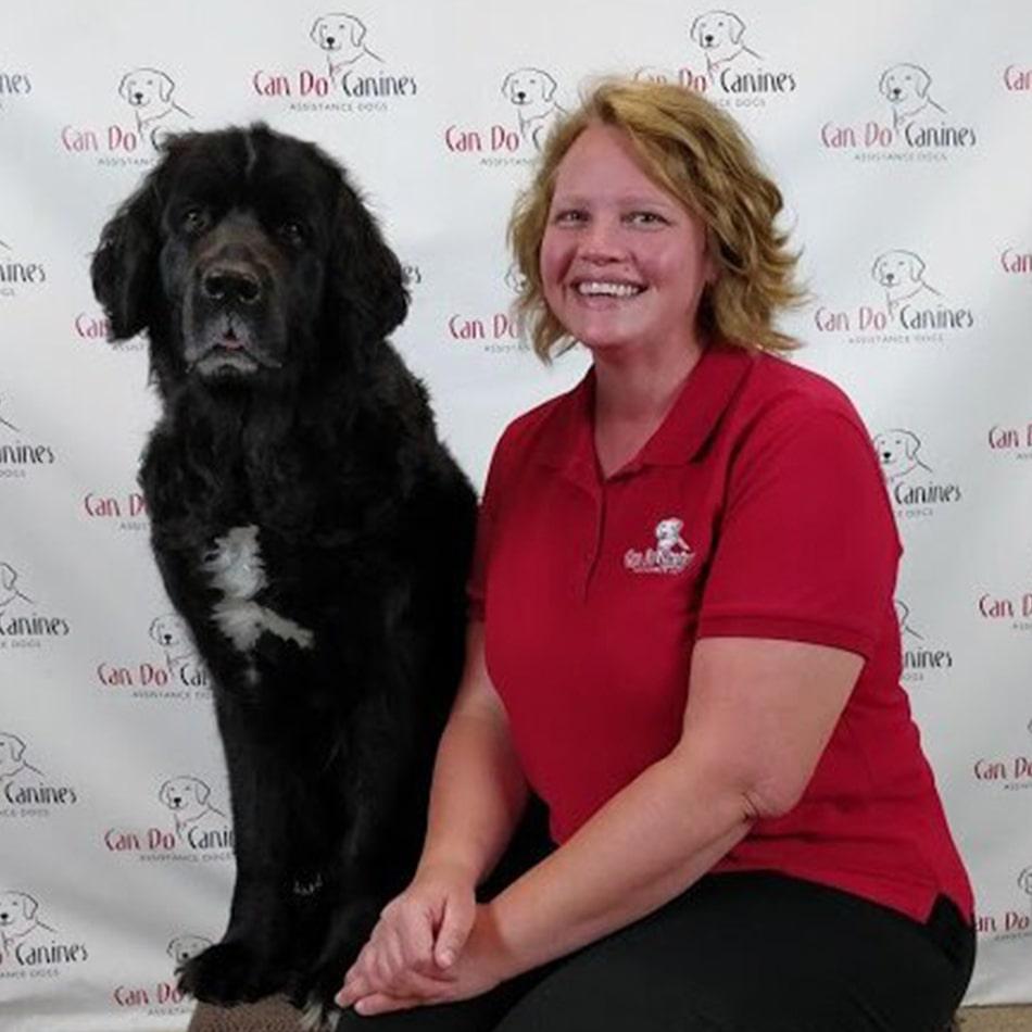 Elizabeth Reberk sitting with a dog