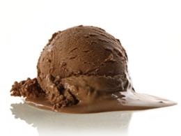 scoop of chocolate ice cream melting on surface