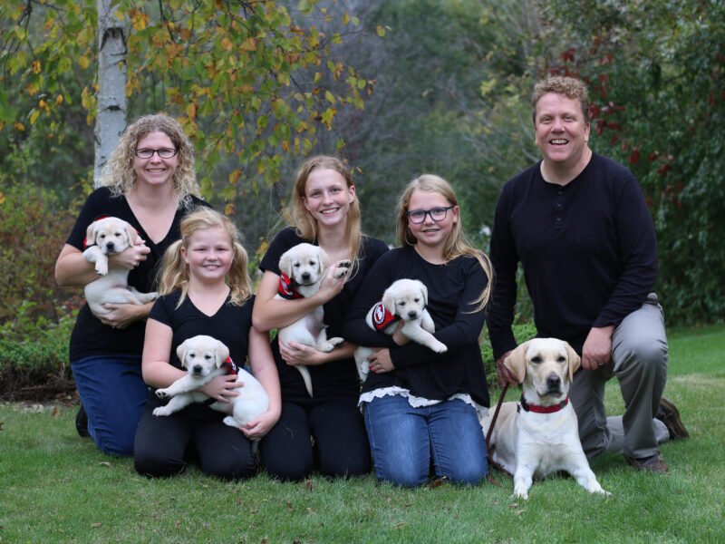 Wahl family with puppies